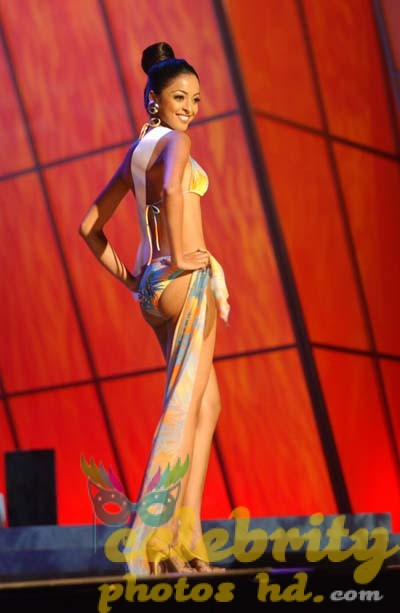 Tanushree Dutta, Miss India Universe 2004, competes in her Endless Sun swimsuit during the 2004 Miss Universe Presentation Show on May 27, 2004 at CEMEXPO in Quito, Ecuador. Each delegate is judged by a preliminary panel of distinguished judges in three categories consisting of individual interview, swimsuit competition and evening gown competition. The scores will be tallied and the top 15 delegates will be announced during the LIVE NBC broadcast of the 53rd annual Miss Universe competition on June 1, 2004 at 9 PM (ET/delayed PT) from Quito, Ecuador. ho/MISS UNIVERSE Organization.