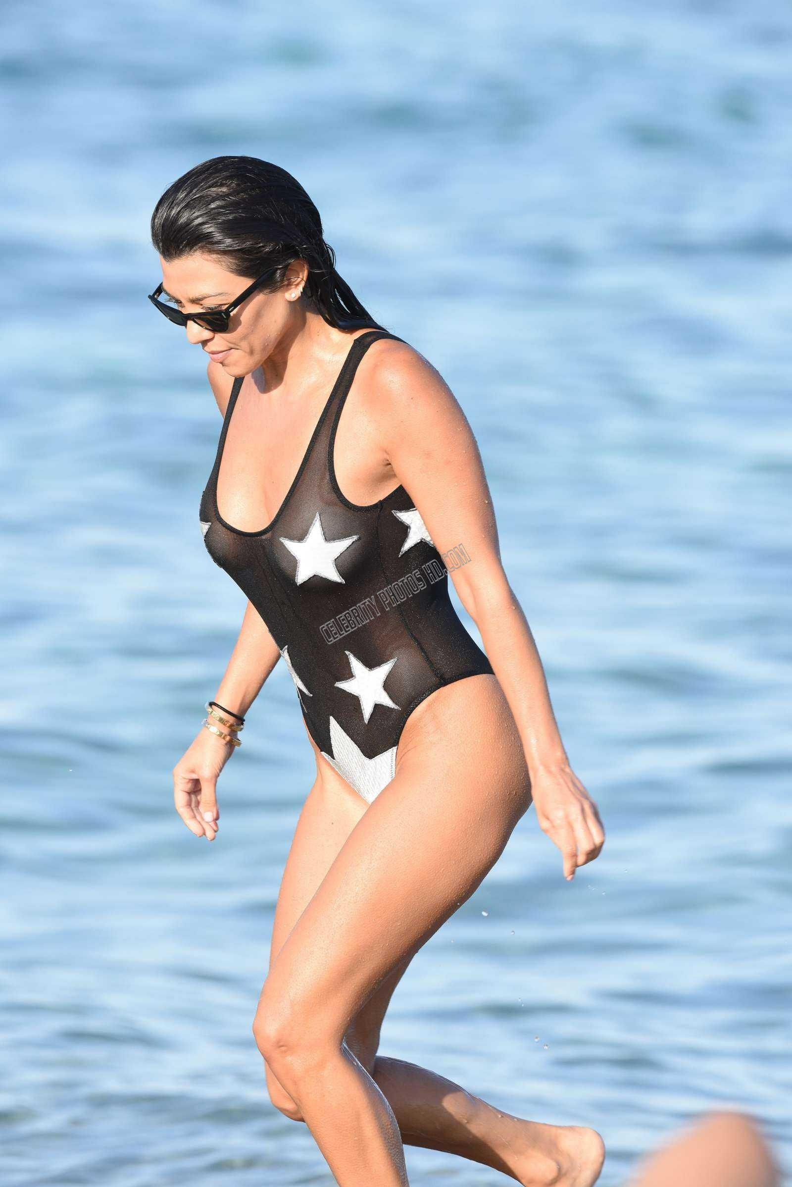 Kourtney Kardashian in Black Swimsuit on the Beach (4)