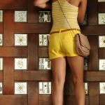Shriya Saran in Yellow Sexy Shorts Hot Stills Photos from Pavitra Movie