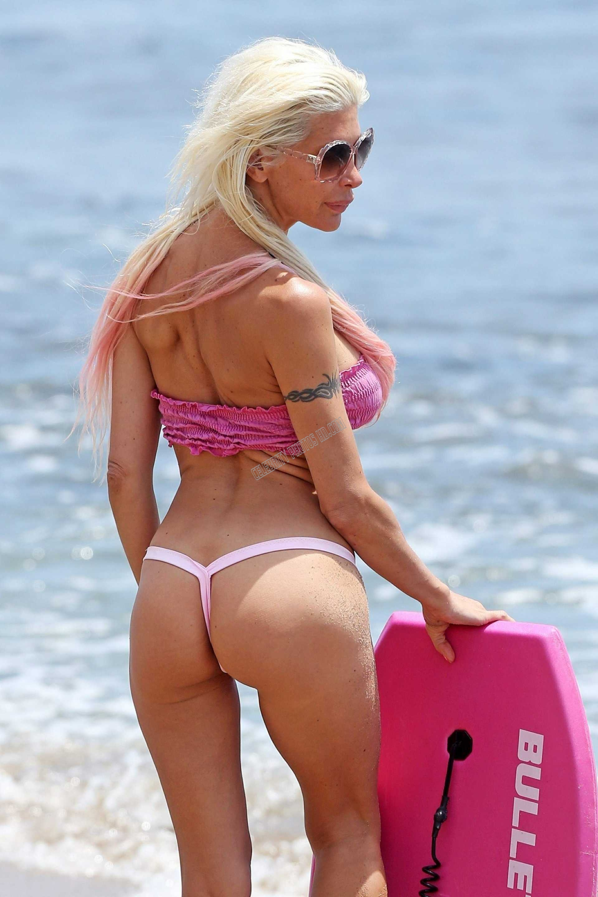 Angelique Morgan Hot angelique morgan on a photoshoot for malibu beach in a pink